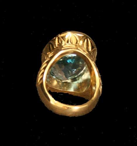 18 karat gold ring set with a blue topaz fj 5561c for